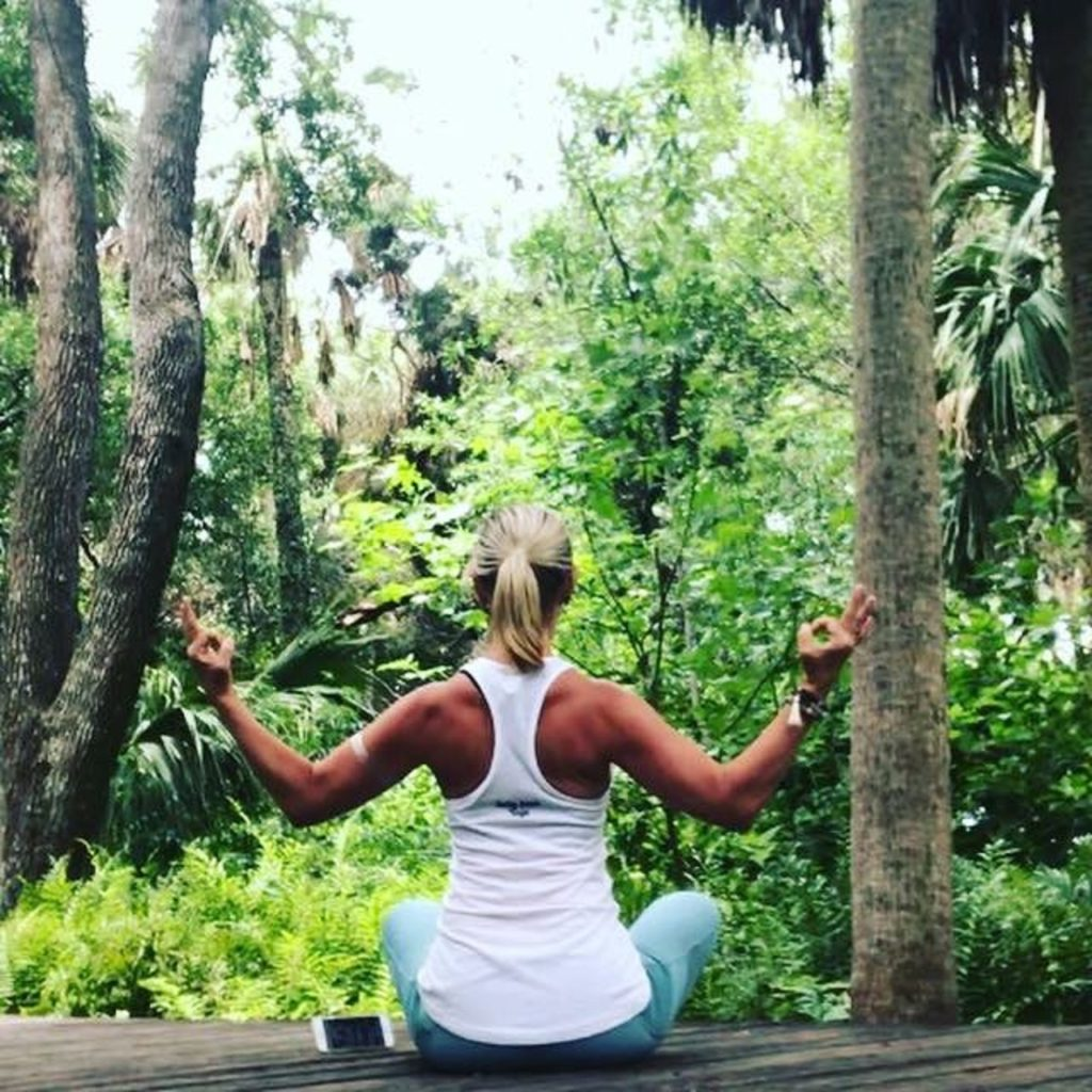 Yoga sitting in forest